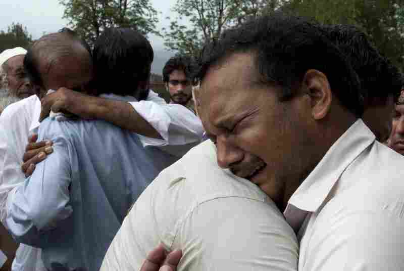 Relatives of the passengers mourn their deaths outside a local hospital in Islamabad.