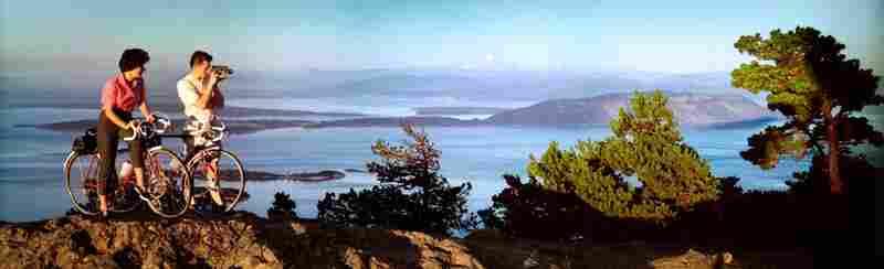 Mountain bikers, Olympic National Park and Strait of San Juan de Fuca, Washington. Displayed 1964
