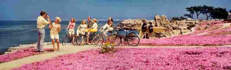 Teenagers on bikes at beach, Monterey Peninsula, California. Displayed 1968