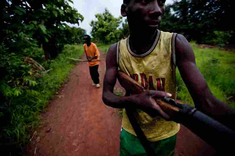 """Members of South Sudan's vigilante """"arrow boys"""" group patrol on May 22 to protect villagers from the Lord's Resistance Army."""