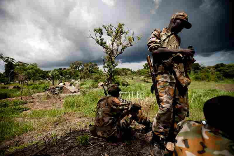 Southern Sudanese soldiers watch over a refugee camp near the border of the Central African Republic, while the U.N. prepares to evacuate refugees.