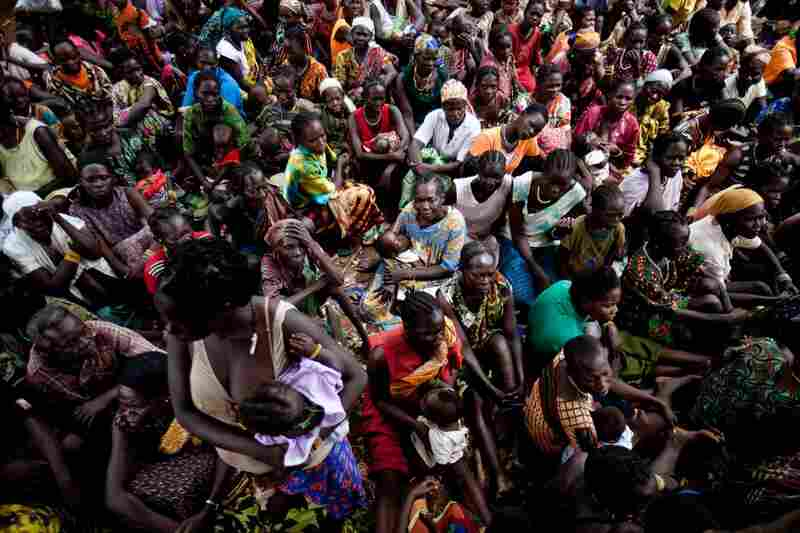 Internally displaced people from Zangia, which the LRA recently attacked, gather in Tambura. A recent flurry of LRA attacks in South Sudan has forced thousands of families to flee from their remote homes.