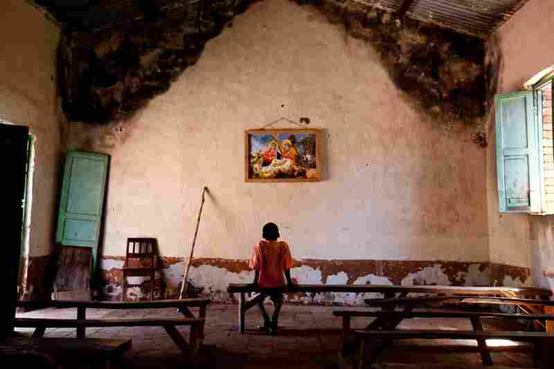 A boy sits in Tambura's Catholic church after the LRA attacked the town's outskirts. The U.N. says the LRA has killed thousands and displaced nearly 100,000 people in South Sudan alone.