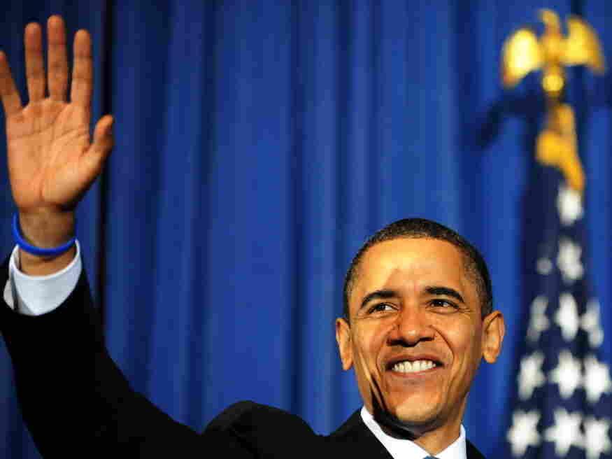 US President Barack Obama waves at the a