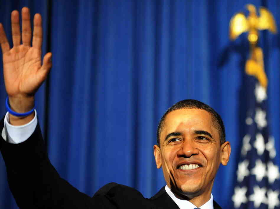 US President Barack Obama waves at the a