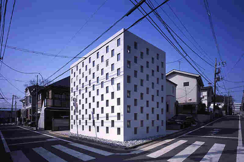 """""""Cell Brick"""" (exterior) is a three-story micro house in Tokyo built in 2004. Architect Yasuhiro Yamashita says he """"cross-stitched"""" steel and glass to create the eye-catching facade."""