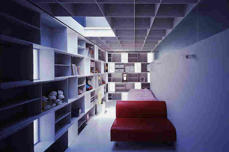 """Built-in steel boxes are whimsical yet practical answer to limited space in the """"Cell Brick"""" home, providing storage and, in the architect's words, """"eliminating monotony""""."""