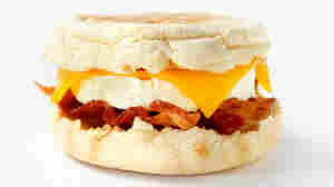 Egg, cheese and bacon on a muffin