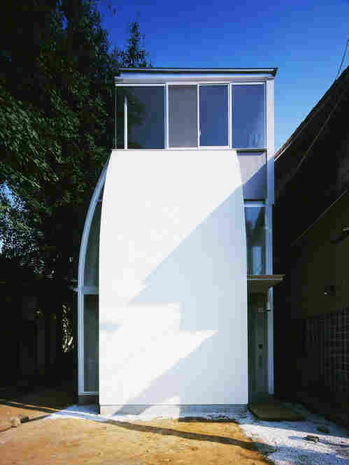 """Built for a couple, the """"Penguin House"""" micro home has windows situated to frame surrounding keyaki trees."""