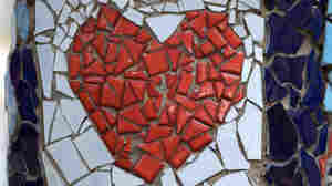Heart mosaic made of tile fragments.