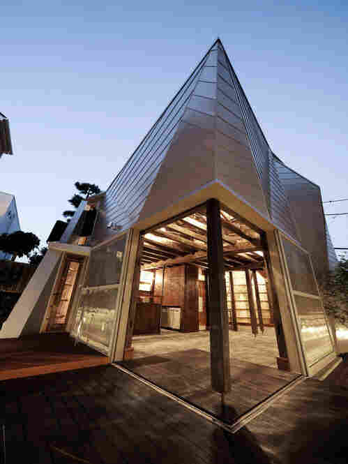 """Timber recycled from century-old warehouses was used to build the frame for the """"Yachiyo House"""" micro home."""