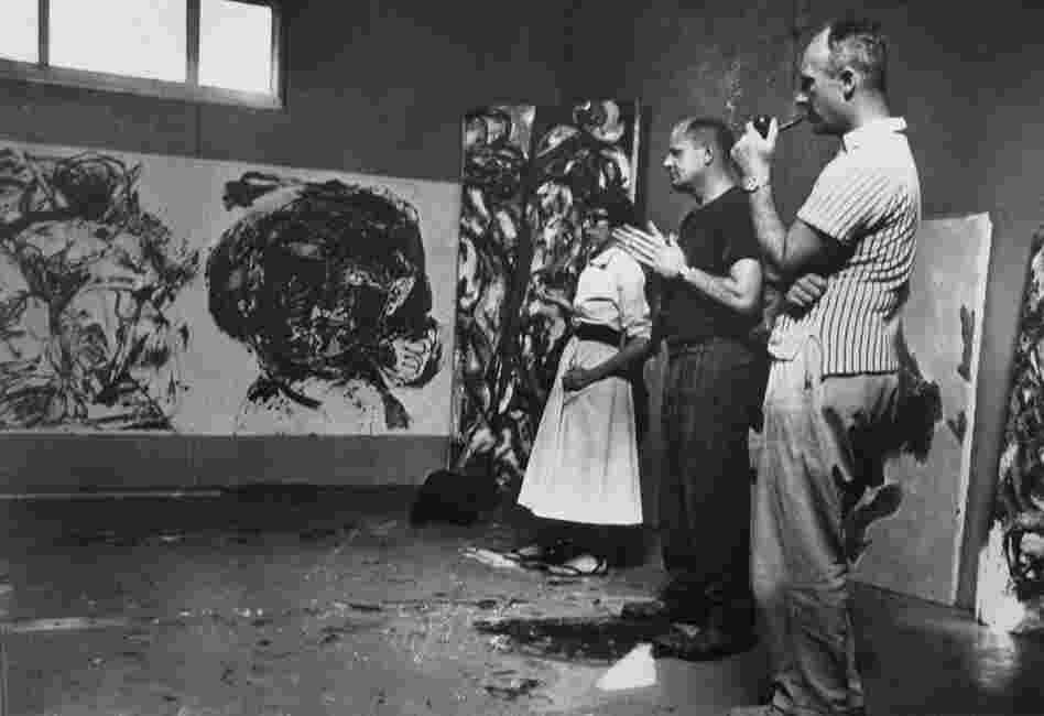 "Krasner and Pollock with Duboff, in Pollock's studio, August 1953. On the wall under the window is Pollock's ""Portrait and a Dream,"" 1953. Behind Lee is ""Ritual,"" 1953."