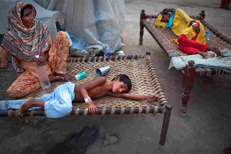 "Yakub, 8, lies next to his mother Aug. 22 at a makeshift hospital in Muzaffargarh in Punjab, where he's receiving treatment for diarrhea. The U.N. warned that up to 3.5 million children are at risk from water-borne diseases and feared a ""second wave"" of deaths from disease after cholera was confirmed in some patients."