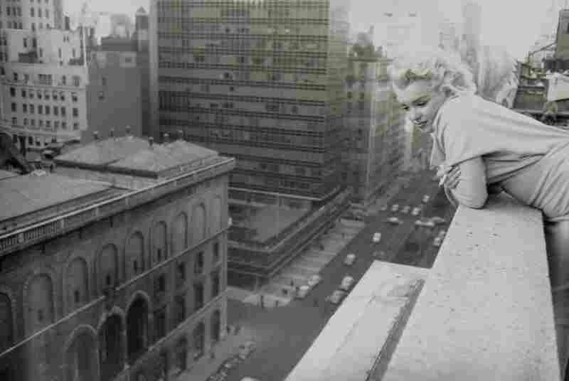 Monroe gazes at the streets of her new home, New York City, 1955.