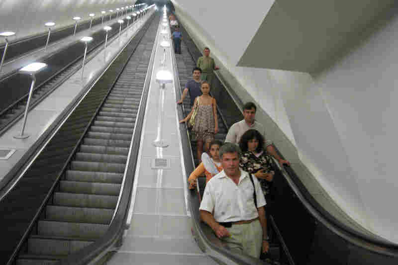 Riders descend a long escalator into the Dostoevskaya station, where the walls are mostly gray. The station has been in the works in Moscow for nearly 20 years, delayed by funding problems and perhaps concern over how it would be received.