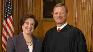 Chief Justice John Roberts and new Justice Elena Kagan after her swearing-in on Aug. 7.