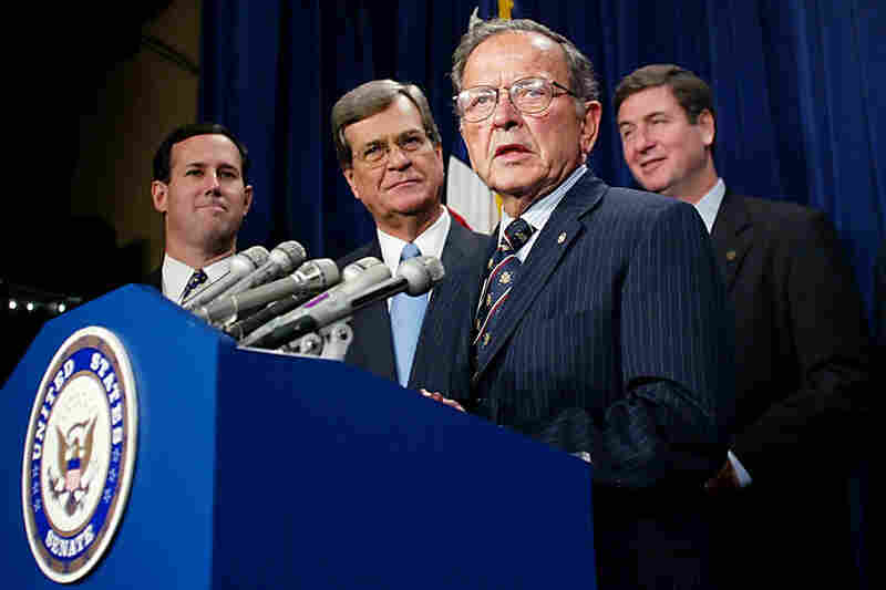 Stevens was introduced by then-Majority Leader-elect Trent Lott (second from left) as the new president pro tempore of the Senate on Nov. 13, 2002.