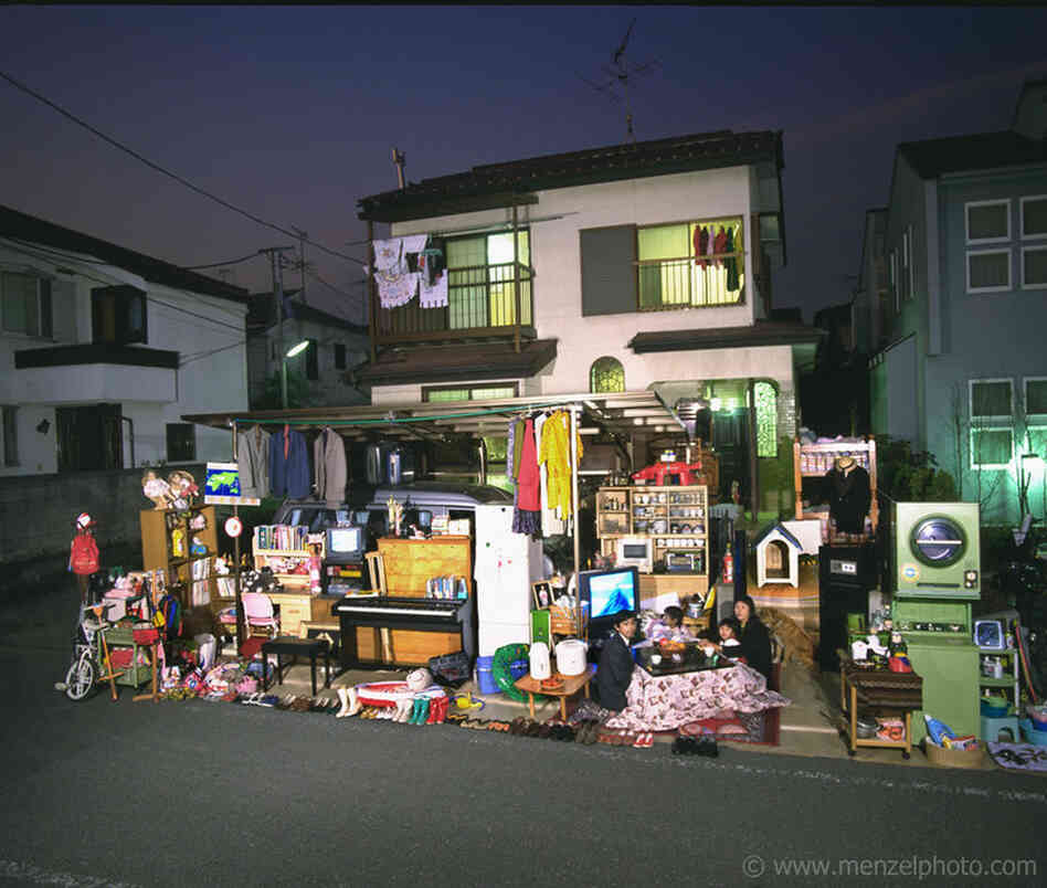"The Ukita family in front of their home in Tokyo. From Peter Menzel's ""Material World"" project, which photographs 30 statistically average families in 30 different countries with all of their possessions."