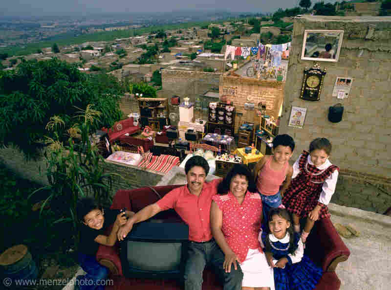 The Castillo Balderas family of Guadalajara, Mexico, outside their home with all of their possessions.