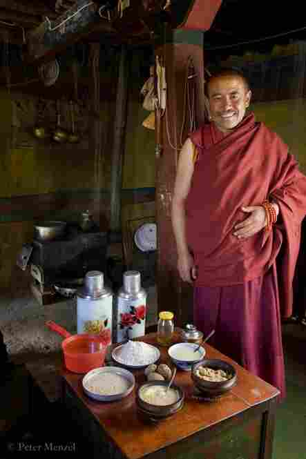 The head monk at his partially rebuilt monastery with a typical day's worth of food in the Tibetan Plateau. He is 45, 5 foot 5, 158 pounds, and his day of calories in June was 4,900 kcals. His food: butter tea, barley flour cake, dried cheese curds, noodle soup with potato, etc.
