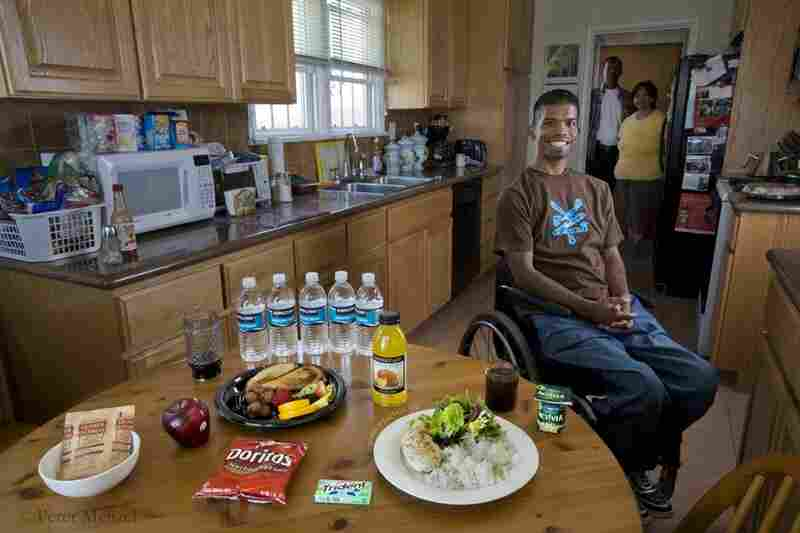 Felipe Adams, a 30-year-old Iraq war veteran with his parents and a typical day of food at their home in Inglewood, Calif. He is 30 years old; 5 food 10 and weighs 135 pounds, and his typical day of calories added up to 2100. Adams was paralyzed by a sniper's bullet while serving in Baghdad, Iraq. His diet includes oatmeal, a chicken sandwich, yogurt, chicken breast and yogurt.