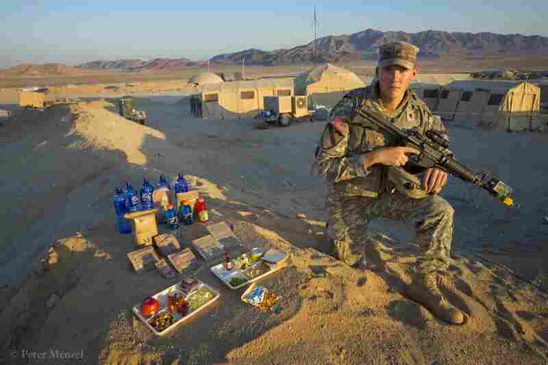Curtis Newcomer, a U.S. Army soldier, with a typical day of food at the National Training Center at Fort Irwin in California's Mojave Desert. He is 20 years old, 6 foot 5 and 195 pounds; his caloric intake on a typical day in September was 4,000 kcals. His lunch consists of a variety of instant meals in the form of MREs (meals ready to eat). His least favorite is the cheese and veggie omelet.