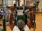 Woman exercises at fitness center for seniors