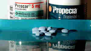 Bottles of the drugs Proscar and Propecia.