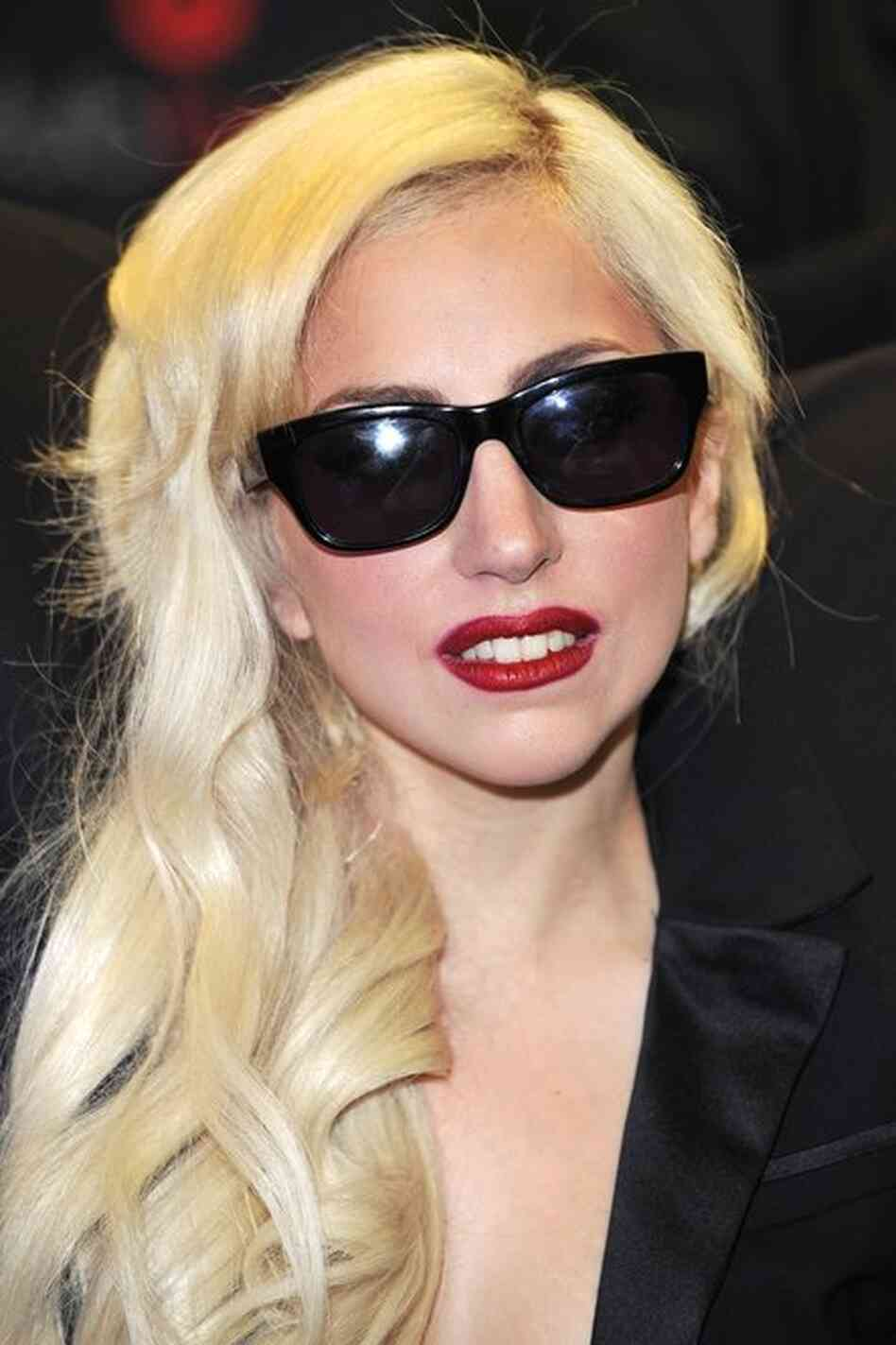 Lady Gaga toned down, but still not wearing her real hair.