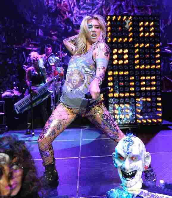 Kesha as her dirty, glittered spattered dumpster-diving outsized persona onstage in New York City on August 2, 2010.