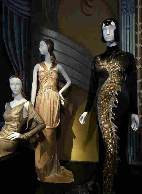 This view of the Screen Siren Gallery includes the Travis Banton gown worn by Anna May Wong in Limehouse Blues (right), as well as a Jesse Franklin Turner gold lame gown (left) and a Chanel gown from 1934.