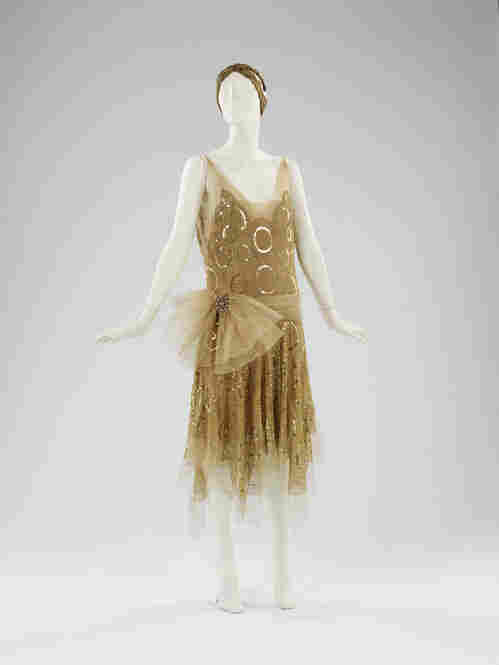 Flapper dresses, like this Lanvin in gold silk with sequins and rhinestones, could be just as elaborate as late 19th century French gowns.