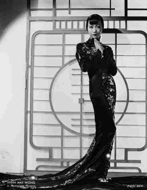In the 1930s, the U.S. began to define the look and style of the day, in part because of the impact of one of America's greatest exports — Hollywood films. Chinese-American movie star Anna May Wong epitomizes the slinky glamour of the decade in a costume by Travis Banton.