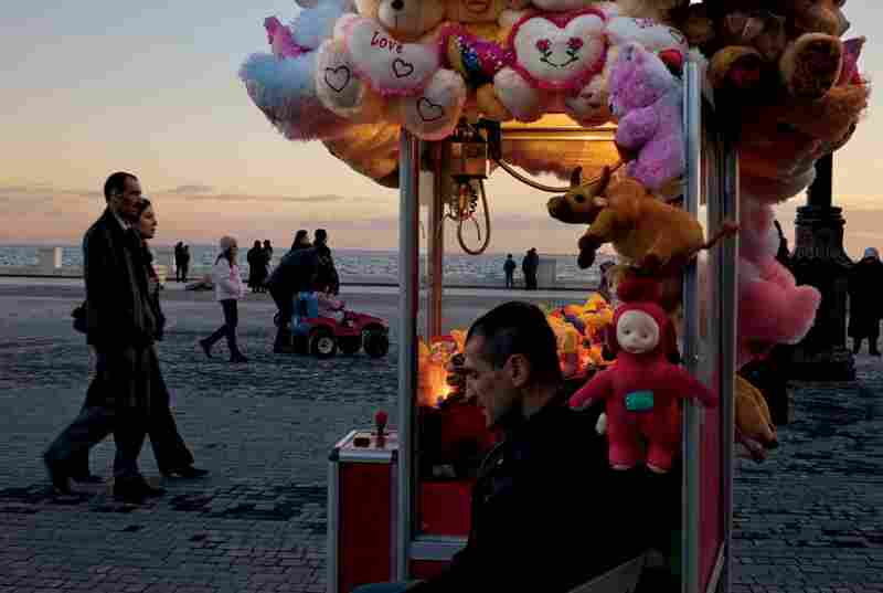 A promenade along the Caspian Sea attracts residents of Baku, the capital of Azerbaijan. Increased oil production has enriched the nation; there are hopes that the new railroad will spur exports.