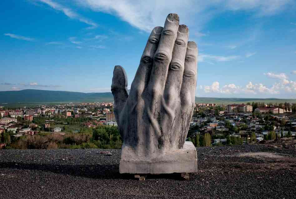 A concrete statue stands above Kars, Turkey, part of a monument of goodwill toward nearby Armenia that may never be completed. The tenuous relationship between Turkey and Armenia has made railroad construction a delicate mat