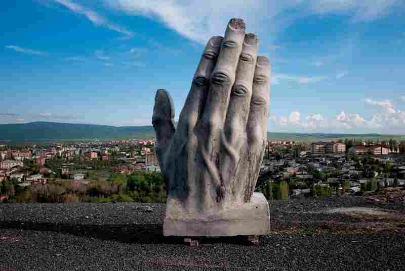 A concrete statue stands above Kars, Turkey, part of a monument of goodwill toward nearby Armenia that may never be completed. The tenuous relationship between Turkey and Armenia has made railroad construction a delicate matter.