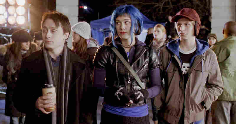 Scott Pilgrim with his girlfriend Ramona Flowers (Mary Elizabeth Winstead) and his roommate, Wallace (Kieran Culkin).
