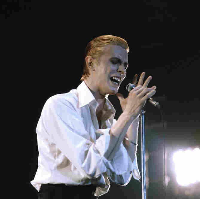 David Bowie is known for many outlandish alter egos in his early career.  But Thin White Duke, his 1976 character associated with Station to Station, was surprising for what it wasn't. Thin White Duke's style was much more subdued, with a classic tailored white shirt and waistcoat.  Although the character looked more normal, his erratic behavior and hollow songs still caused a stir. (Mic...