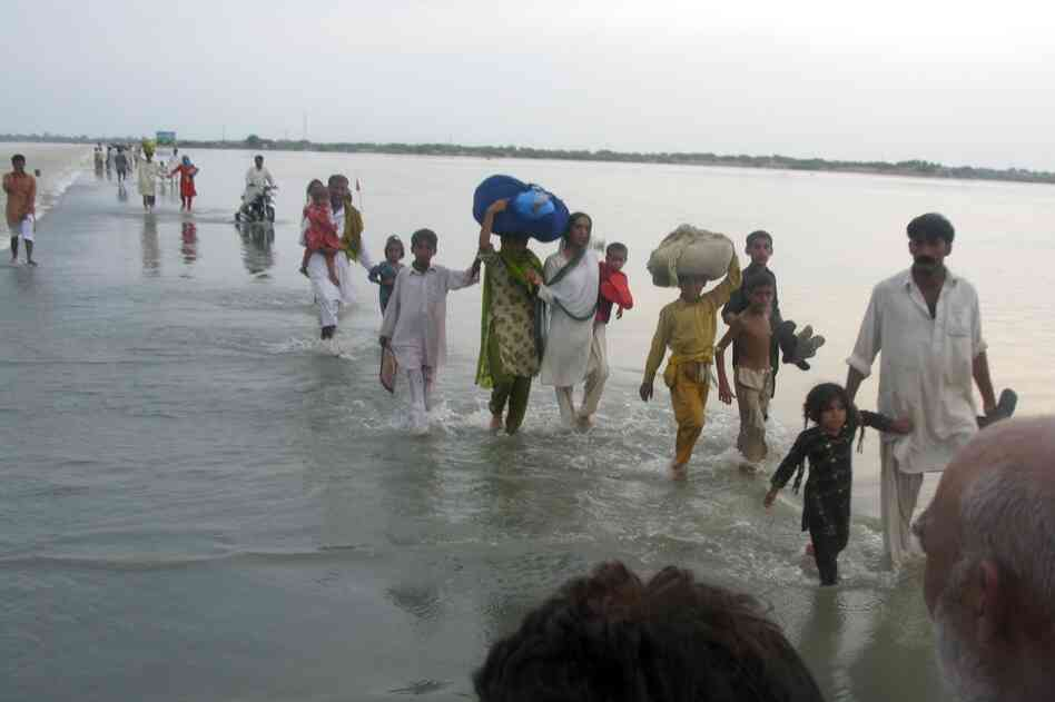 Floods have ravaged Pakistan's southern Punjab province, destroying homes, stranding people, and damaging more than 20 pe
