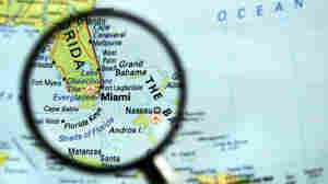 Miami map under a magnifying glass.