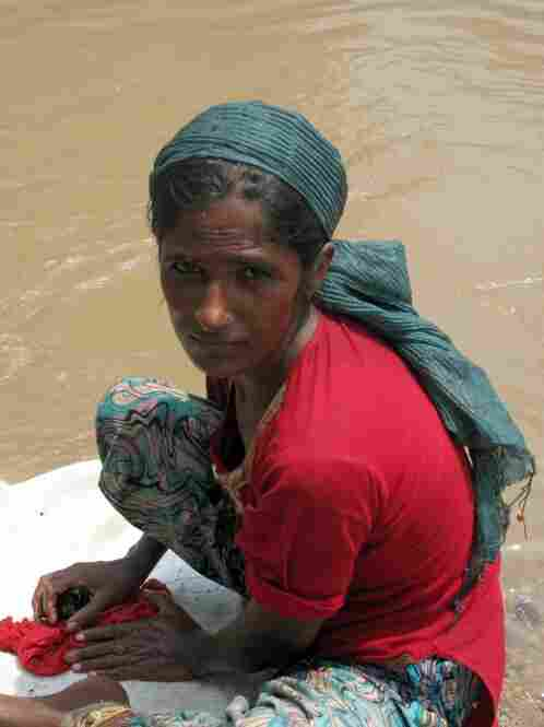 Tasleem Mai, 25, was washed out of her home near Muzaffargarh when the Indus River reached levels not seen in living memory. She now lives on the edge of the water-logged road with her four children. Most flood victims have not gone to camps, but are staying near their homes to ensure against theft.