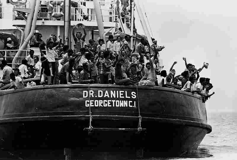 Cuban refugees celebrate their safe arrival at Key West, Fla., on May 6, 1980. About 125,000 Cubans, many of them released convicts, fled to the U.S. in what became known as the Mariel boatlift.