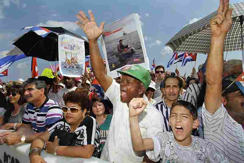 Cuban-Americans protest at Miami's Opa-locka Airport on Feb. 24, 1996, after Cuban fighter jets shot down two planes — operating for an anti-Castro exile group — near Cuba. The U.S. strengthened its trade embargo.