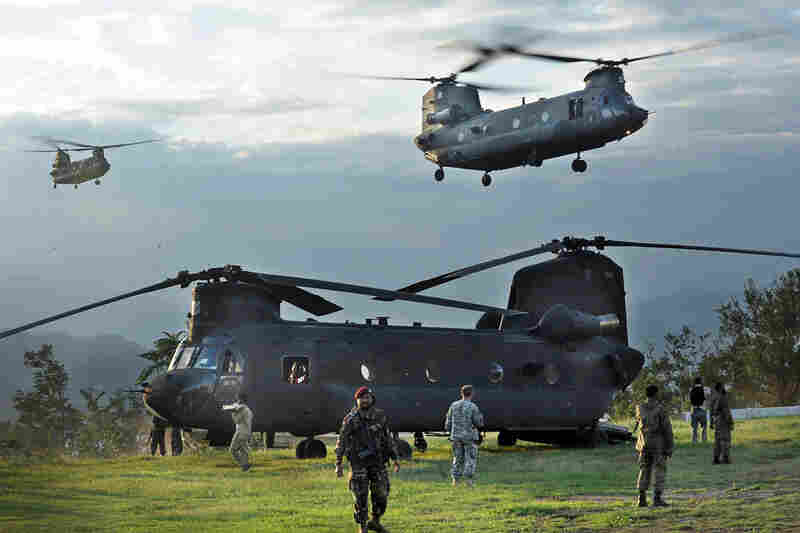 U.S. Chinook helicopters carrying flood survivors arrive Aug. 9 in Khwazakhela in the Swat Valley. As anger mounts among survivors, the Pakistani government and U.N. officials have appealed for more urgent relief efforts.