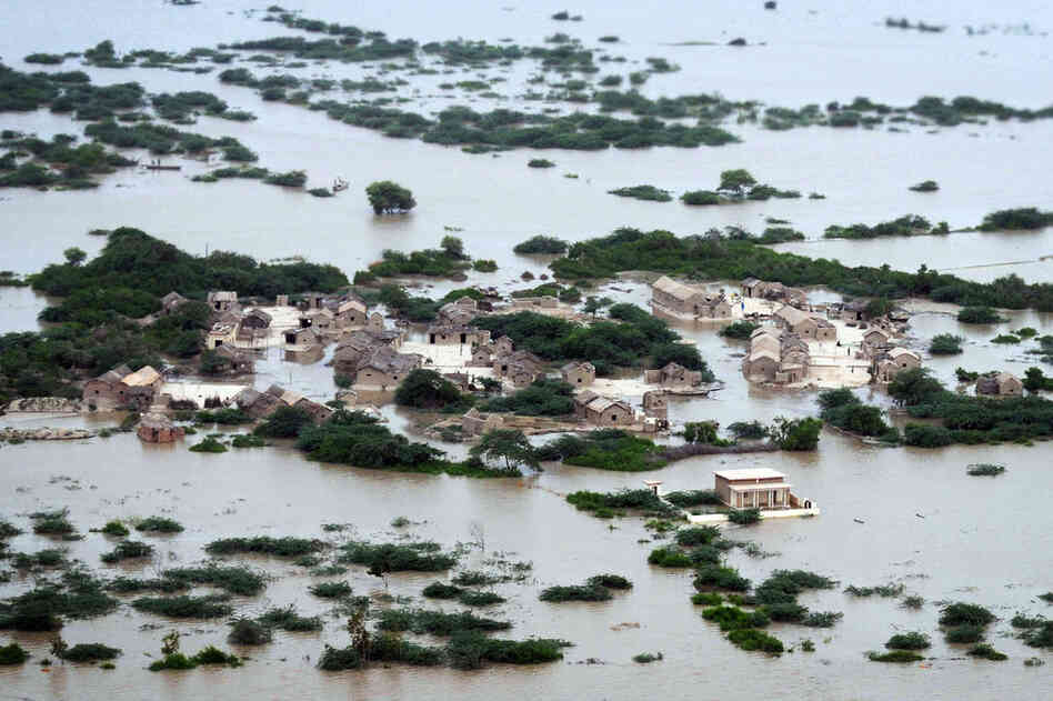 An aerial view shows the flooded Kharo Chan village in Pakistan's Sindh province on Aug. 25. The United Nations has described the widespread flooding in Pakistan as unprecedented, with more than one-third of the nation underwater. Officials say as many as 20 million people have been affected during Pakistan's worst flooding in 80 years.