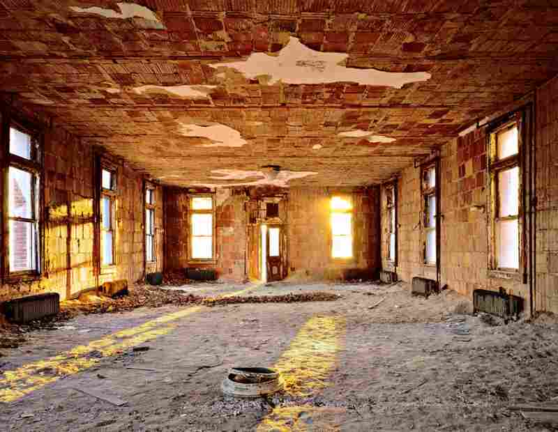 "Hospital Extension, Women's Ward, Island 2. ""It felt like a room unearthing itself. The pulverized plaster from the ceiling gave this room, where children with head lice and ringworm once slept, the character of a desert."""