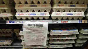 A sign in a Los Angeles supermarket warns customers about a recall of certain lots of eggs that had