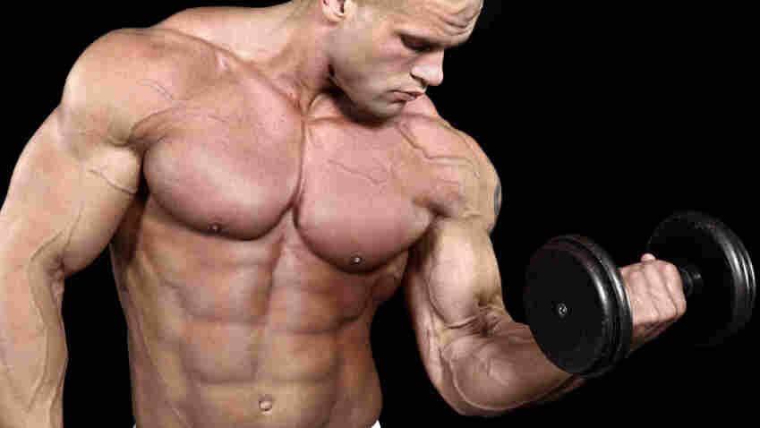 A man lifts a weight