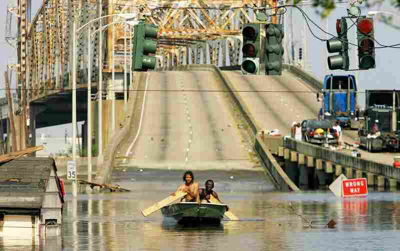 Two men paddle in high water after Hurricane Katrina devastated the area on Aug. 31, 2005.