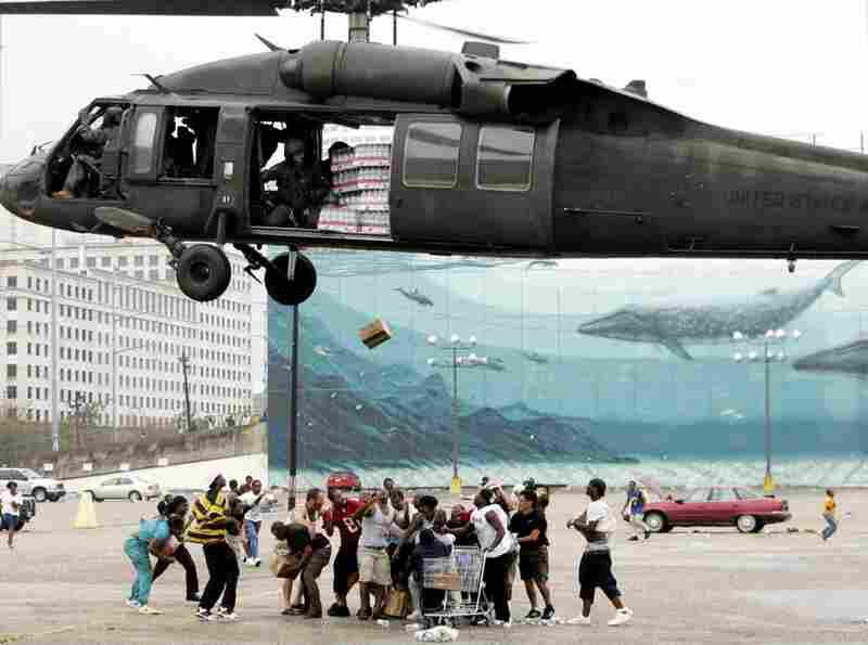 A military helicopter makes a food and water drop to flood victims near the convention center on Sept. 1, 2005. Officials called for a mandatory evacuation of the city, but many residents remained in the city and had to be rescued from flooded homes and hotels.